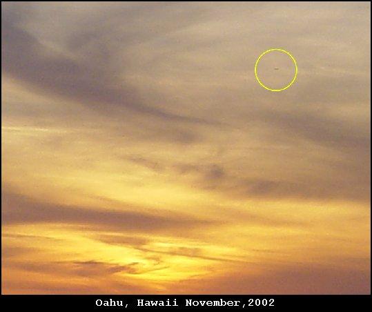 Silver disc UFO over Oahu, Hawaii - November, 2002