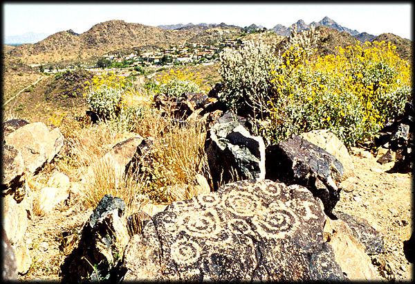 Ancient Hohokam spiral petroglyphs decorate a basalt boulder on Shaw Butte, in Phoenix, Arizona