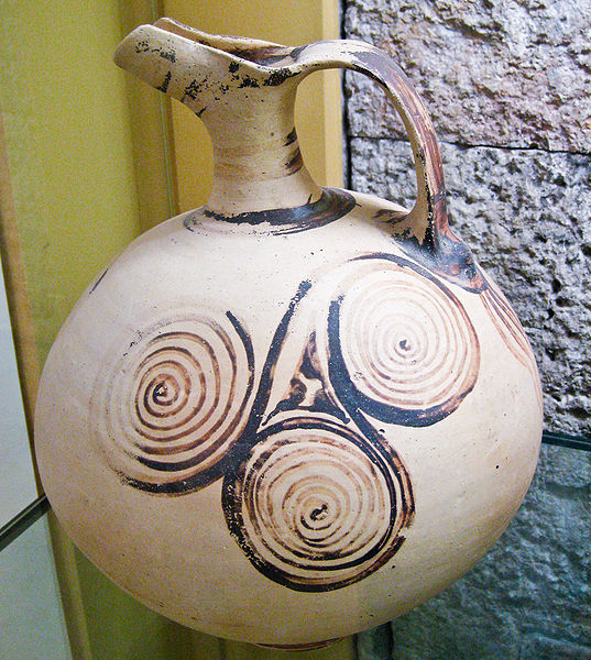 Ancient greek beaked jug decorated with triple spirals