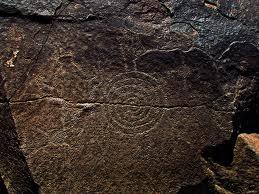 Ancient Spiral Petroglyph Rock Wall