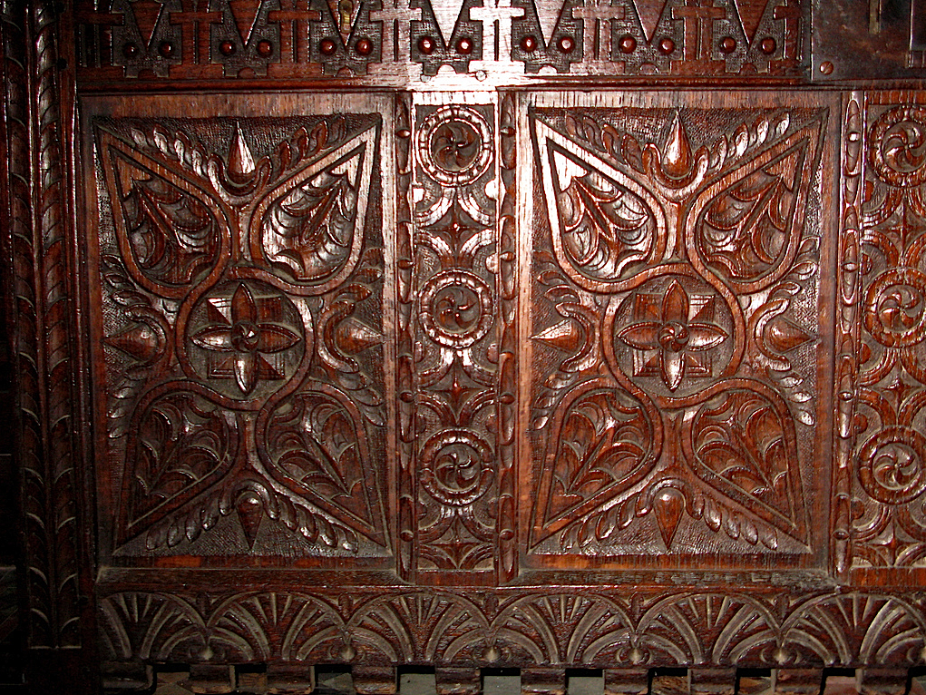Carved chest detail, Baptistry, Swastika Symbols