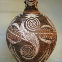 Jug from Faistos with large double spiral Kamares style 200x200 Ancient Swastika
