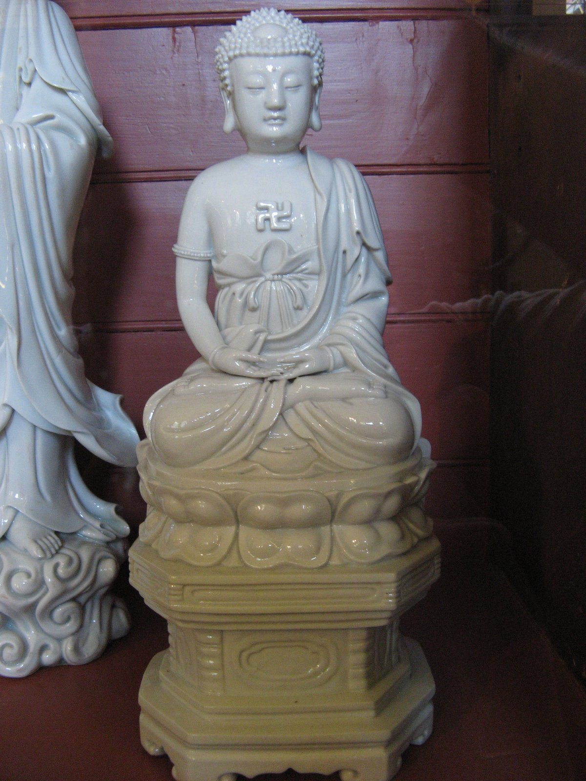 Chinese Ceramic Statue with Swastika